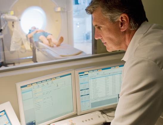 Doctor with MRI machine